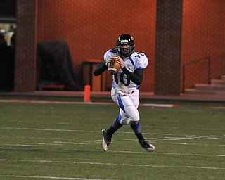 YCA QB #10 Emmit Underwood scrambles out of the pocket during the 2nd quarter..