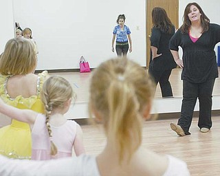Teri Nobbs, owner of Stage Door Fine and Performing Arts School in Poland, leads a tap-dance class. The recently opened school teaches all types of the performing arts but does not participate in competitive events.
