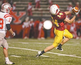 Senior wide receiver Ryan Farragher, shown here in a first-round playoff game against Canal Fulton Northwest, made two clutch catches on Cardinal Mooney's final drive, helping to set up the game-winning field goal.