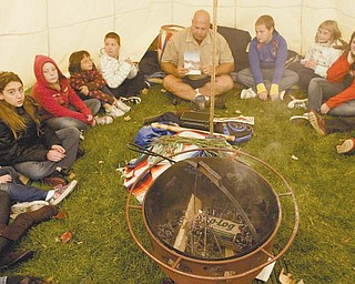 Wes Jones, owner of Native Life Tipi Rental, set up camp on the lawn of Struthers Elementary School. He began teaching classes in Native American culture Monday and will continue to do so through Thursday.