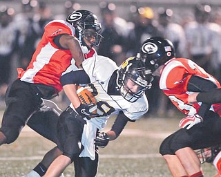 Black River running back Zach Marror (28) is tackled by a Girard defender as James Cupan (33) of the Indians comes in to help. Girard plays Norwayne on Saturday night in the Division IV, Region 13 championship game.