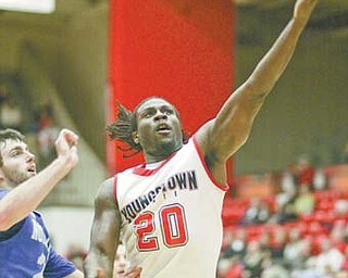 Youngstown State's Ashen Ward scores on a layup against Notre Dame College's Phil Biggs during the first half of Tuesday's game at the Beeghly Center.
