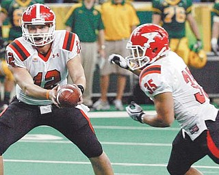 Youngstown State QB Kurt Hess (12) hands the ball to Jamaine Cook (35) during last Saturday's win 27-24 win over North Dakota State University at the Fargodome in Fargo, N.D. On Saturday, the Penguins face Missouri  State, which is 1-9 and a team that YSU will not be taking lightly says Hess.