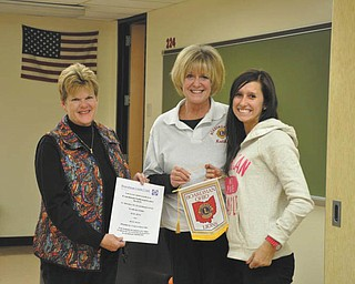Helping to get coats for kids: Boardman High School's National Honor Society recently contributed $300 to the Boardman Lions Club's Coats for Kids Drive. The money, the club's largest donation to date, helped the Lions buy 52 winter coats for 26 area families. From left to right are Lions Betsy Koch and Kathy Collins and NHS President Faith Marsco. Other NHS projects this year were Coins for Kids for Akron Children's Hospital, tutoring and volunteering at Angels for Animals. The club also plans to participate in the Lions' White Cane Collection Day, Nov. 23. Mary Beth Shobel, a Boardman Lion, advises the club.