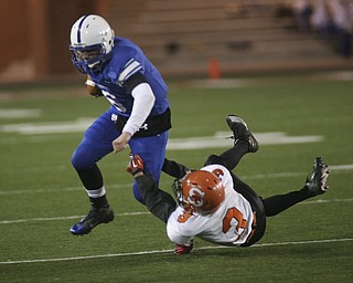 ROBERT  K.  YOSAY  | THE VINDICATOR --..Regional Finals   WR  #6  QB Jeff Clegg runs through Shadyside 3 Dylan Merryman as he goes for a first down in the first quarter.--30-..(AP Photo/The Vindicator, Robert K. Yosay)
