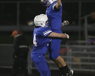ROBERT  K.  YOSAY  | THE VINDICATOR --..Regional Finals -  #2 WR Donnie Bolton celebrates after recovering a blocked kick that he ran in for a touch down making it 28-7 just before half - #4  Mitch Shahaden is with him.--30-..(AP Photo/The Vindicator, Robert K. Yosay)