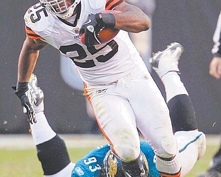 Cleveland Browns running back Chris Ogbonnaya (25) leaves Jacksonville Jaguars DT Tyson Alualu (93) in the dust as he breaks a tackle during the fourth quarter of Sunday's NFL game in Cleveland. Ogbonnaya rushed for 115 yards on 21 carries and a touchdown in the Browns' 14-10 win over the Jaguars.