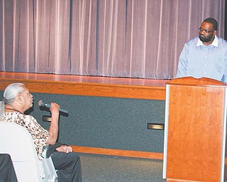 """At Sunday's """"The War on Youth Violence"""" presentation at East High School, Patricia Eiland of Austintown tells Pastor Cecil Monroe how she believes violence can be prevented."""