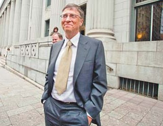 Microsoft co-founder and chairman Bill Gates leaves the Frank E. Moss federal courthouse in Salt Lake City on Monday after testifying in a $1 billion antitrust lawsuit brought by Novell Inc.