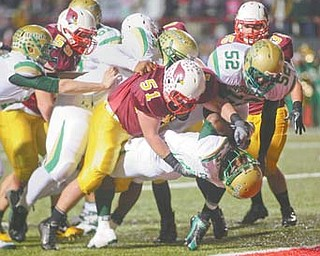 Mooney defender Carmen Lanzo (51) grabs Ursuline's Jesse Curry during their game in Week 9. Lanzo's Cardinals will play Chagrin Falls on Friday in a state semifinal.