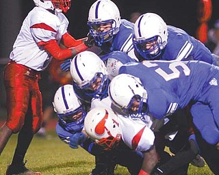 Western Reserve's Sam Steininger (57) and friends smothered VA-SJ quarterback Anthony Sywanyk for a big loss in a Week 11 playoff game. Saturday, the Blue Devils will play in their first state semifinal game.