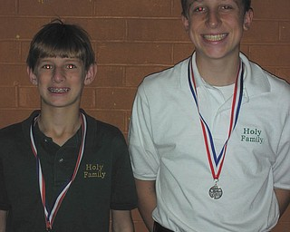 Running in the right direction: Mario Abbattista Jr., left, and Nick Braydich, two eighth-graders from Holy Family School, placed in Habitat for Humanity's 5K Home Run Race in Poland. Braydich was 29th overall and placed second in his age group. Abbattista was 30th and placed third in his age group. Approximately 150 runners participated in the race.