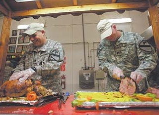 U.S. soldiers serve the last Thanksgiving meal at Contingency Operating Site Echo in Diwaniyah, 80 miles south of Baghdad, Iraq.