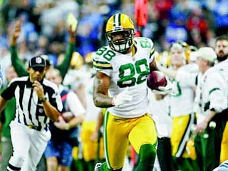 Green Bay Packers tight end Jermichael Finley (88) runs after a catch against the Detroit Lions in the second quarter of an NFL football game in Detroit on Thursday. The Packers won 27-15.