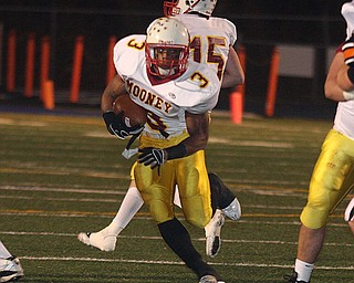 FOOTBALL - (3) Rosevelt Griffin hits the hole Friday night in Uniontown. - Special to The Vindicator/Nick Mays