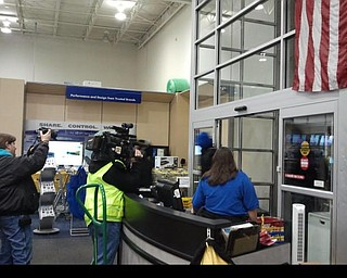 Shoppers enter Best Buy peacefully at midnight