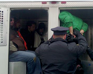 Police arrested seven protesters today after they blocked trucks from entering and leaving a D&L Energy well site.