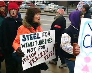 About 100 fracking protestors are standing outside the First National Tower downtown calling for a moratorium on fracking. The protestors also marched around the Covelli Centre, the site of today's Youngstown Ohio Utica and Natural Gas conference and expo.