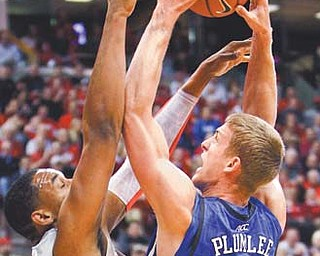Duke's Mason Plumlee, right, attempts to shoot over Ohio State's Jared Sullinger during the first half of a game Tuesday in Columbus.