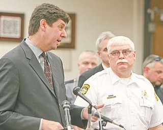 Steven Dettelbach, left, U.S. attorney for the Northern District of Ohio, and Warren Police Chief Tim Bowers were among law-enforcement participants on hand Tuesday for an update in Warren on the Violence Gun Reduction and Interdiction Program.