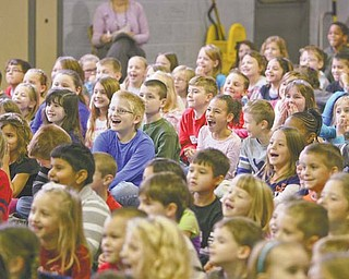 Students from kindergarten through third grade at Lloyd Elementary School in Austintown enjoy a visit from the J.J. Brothers, authors from Akron who travel to schools to promote reading and writing.