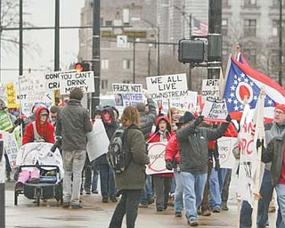 About 100 fracking protesters marched downtown Wednesday during the Youngstown Ohio Utica and Natural Gas conference. Many want a moratorium placed on fracking, a process in which water, chemicals and sand are blasted into rocks to unlock natural gas and oil.