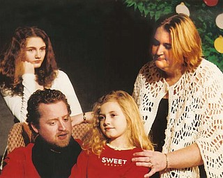 """From left, Miranda Canacci, Chuck Kettering, Gillian Canacci and Brittiani Ketcham in a scene from """"The Most Beautiful Star,"""" one of three one-act plays that comprise """"In the Spirit of Christmas"""" at The Victorian Players Theater."""