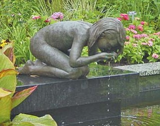 The Kneeling Girl, which was stolen Nov. 23 from Fellows Riverside Gardens, has been found. The Gardens will store the statue until the spring, then restore it to its perch above this pool in the Beeghly Garden.