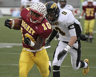 Justin Ellis Moore out runs Shawnee #9 Jordan Huggins as he gets a first down. Youngstown Cardinal Mooney won their 8th championship as they beat the Shawnee Braves in Fawcett Stadium  21-14. (AP Photo/The Vindicator, Robert K. Yosay)