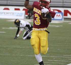 Roosevelt Griffin barely steps out of bounds on a 36 yard run. Youngstown Cardinal Mooney won their 8th championship as they beat the Shawnee Braves in Fawcett Stadium  21-14. (AP Photo/The Vindicator, Robert K. Yosay)