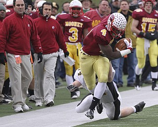 #4 Marcus McWIlson gets pushed out of bounds by Shawnee #14 Dusty Seelig on a runback after a punt in first half action. Youngstown Cardinal Mooney won their 8th championship as they beat the Shawnee Braves in Fawcett Stadium 21-14. (AP Photo/The Vindicator, Robert K. Yosay)