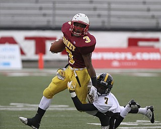 Mooneys #3 Roosevelt Griffin stiff arms and gets away from Shawnee #7 James Williams during first half action. Youngstown Cardinal Mooney won their 8th championship as they beat the Shawnee Braves in Fawcett Stadium  21-14. (AP Photo/The Vindicator, Robert K. Yosay)