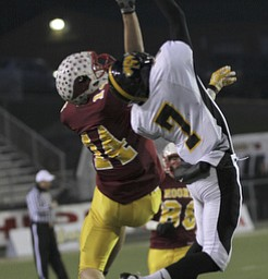 Shawnee #7  James Williams and #14 Mooney Ryan Farragher fight for the ball during second half action. Youngstown Cardinal Mooney won their 8th championship as they beat the Shawnee Braves in Fawcett Stadium  21-14. (AP Photo/The Vindicator, Robert K. Yosay)