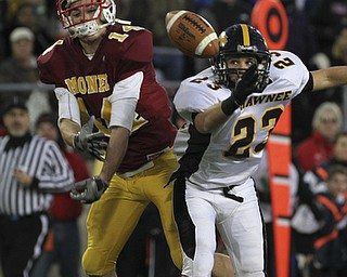 Broken up pass as Mooneys #14 Ryan Farragher has the ball knocked away by Shawnee #23 Drew Young. Youngstown Cardinal Mooney won their 8th championship as they beat the Shawnee Braves in Fawcett Stadium  21-14. (AP Photo/The Vindicator, Robert K. Yosay)