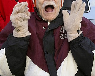 JESSICA M. KANALAS | THE VINDICATOR..William Craft, 92, of Youngstown expresses his joy for the holiday season during the holiday parade in Downtown Youngstown.
