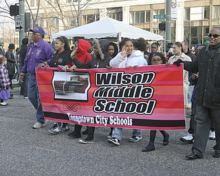 JESSICA M. KANALAS | THE VINDICATOR..Wilson Middle school  students wave during the holiday parade in Downtown Youngstown.