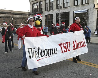 JESSICA M. KANALAS | THE VINDICATOR..YSU alumni members walk during the holiday parade in Downtown Youngstown.