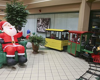 JESSICA M. KANALAS | THE VINDICATOR..Children take a ride on a train after the parade in Downtown Youngstown.