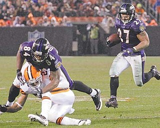 Baltimore running back Ray Rice (27) looks for room to run as tight end Ed Dickson takes out the Browns' Joe Haden in the second quarter of Sunday's game in Cleveland. The Ravens won 24-10.