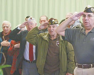 Veterans salute during the Pledge of Allegiance during an observance of the 70th anniversary of the Japanese attack on Pearl Harbor in Hawaii on Dec. 7, 1941. The event was Wednesday at AMVETS Post 44 in Struthers.