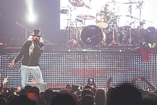 Axl Rose, lead singer of the rock band Guns N' Roses, performs at the Covelli Centre in downtown Youngstown on Wednesday night. Coincidentally on Wednesday, GNR also was selected for induction into the Rock and Roll Hall of Fame in Cleveland next April. Rose took to the Covelli stage at about 11 p.m. Wednesday.