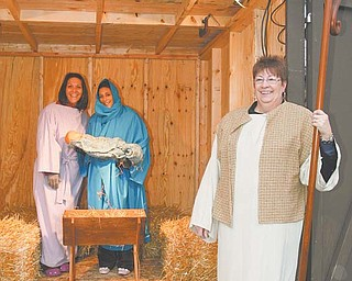 From left, Cara Carramusa, Agapi Mantos and Jackie Pauley, all employees at Park Vista Retirement Community on Fifth Avenue, Youngstown, dress up as a part of the live Nativity display outside the Park Vista campus. Carramusa, Mantos and Pauley took the first 30-minute shift in the manger, just as snow began to fall Wednesday night.