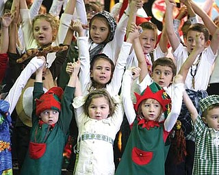 Students at Lloyd Elementary School in Austintown during a final song in the students' Holiday Around the World program. The show featured facts about the way other cultures celebrate the holidays. More than 100 family members and friends attended the show Thursday.