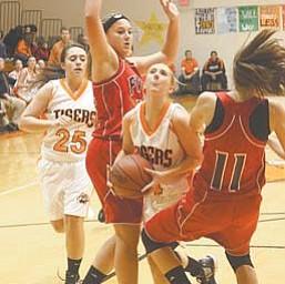 Newton Falls' Rachel Ellis, center, tries to split Fitch defenders Cassie Custer, left, and Megan Sefcik (11) as Falls' Victoria Workman (25) trails during Thursday's game in Newton Falls.