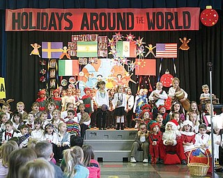 First-grade students at Lloyd Elementary School in Austintown entertain more than 100 friends and family members during their Holiday Around the World program. During the show, the students danced, sang and shared facts about how other cultures celebrate the holidays.