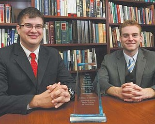Youngstown State University seniors Travis Watson, left, and Kevin Hulick, both of Austintown, won first place at the Midwest Regional Tournament of the American Collegiate Moot Court Association. They head to the national competition next month.