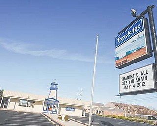 The sign in front of the Travelodge at 1811 East Perry Street in Port Clinton, Ohio, thanks its customers and says it will see them again in May 2012. Workers along Lake Erie face layoff s every winter as tourism declines for the season.