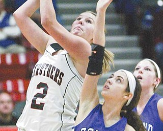 Struthers' Ashley Hefferon shoots past Poland's Abby Brenoel during the first quarter of Monday's game at the Struthers Fieldhouse.