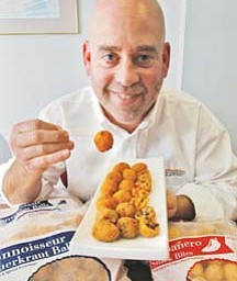 Keith Kropp, CEO of Or Derv Inc. in Akron, showcases the new Olivation line of products and the traditional sauerkraut balls.