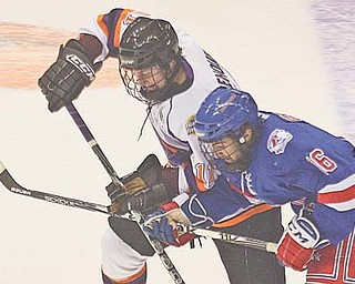 Daniel Renouf (11) and the Youngstown Phantoms will face off against Anthony Greco (16) and the Des Moines Buccaneers on Saturday in the second contest of a pivotal fi ve-game swing, which begins tonight in Green Bay, Wis., against the league-leading Green Bay Gamblers. With a record of 14-6-1 and 29 points, the Phantoms are in second place.